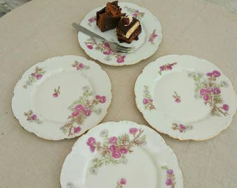 4 antique French side plates. Limoges porcelain tea plates by La Seynie. Purple and green thistle design.