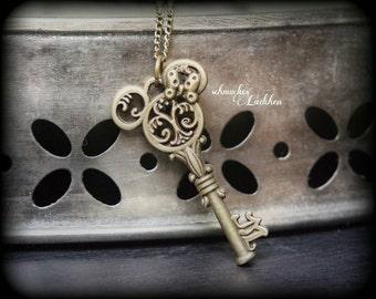 """Antique bronze Disney chain """"Minnie Mouse"""" key"""