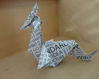 Great dragon origami. Pattern words in black ink
