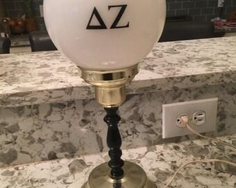 Vintage antique Delta Zeta round white globe lamp from late 1960's