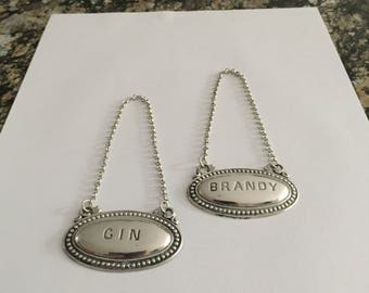 Pair Silver Plated Decanter Labels - Brandy, Gin, mid 20th century