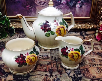 Sadler teapot and cream and sugar set