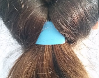 This colorful Tail Cuff ponytail accessory, slides onto your own ponytail holder in 7 seconds, for a finished tail.  It will last forever.