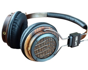 alligator with black chrome designer headphones