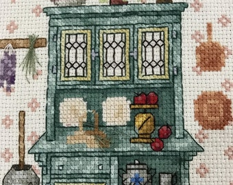 Completed counted cross stitch kitchen cupboard design