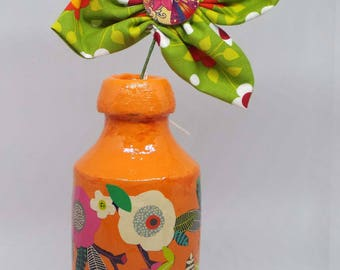 Decoupaged rustic vase with green fabric flower