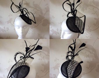 Black and cream fascinator on base