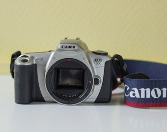 Canon EOS 300 35mm film SLR camera - with original Canon camera strap - Tested and working film camera