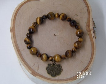 B1251 Tigers Eye Bracelet with Chinese coin.