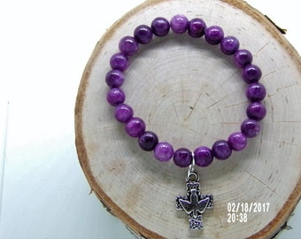 B021715  Purple Ceramic Beaded Bracelet with a Silver Dove & Cross Charm.