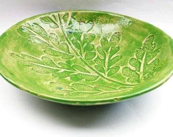 Pottery / ceramic green bowl with a impressed leaf design / pattern perfect for dining, home decor, trinkets, food.