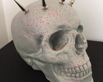 Silver and Pink splatter glow in the dark skull. Metal punk spikes