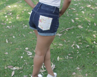 Denim shorts with floral print pockets