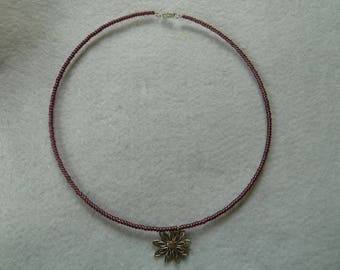 Ripe purple beads and flower pendant necklace