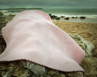 Baby crocheted pale pink blanket.