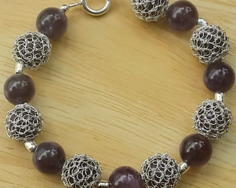 Handmade bracelet. Wire silver crochet and amethyst beads.