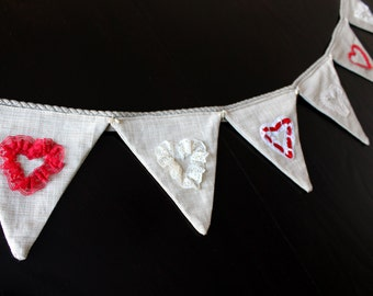 Garland of Valentine flags with embroidered hearts patterns