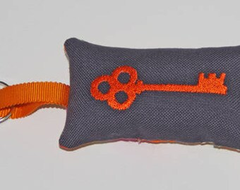 Orange embroidered key ring