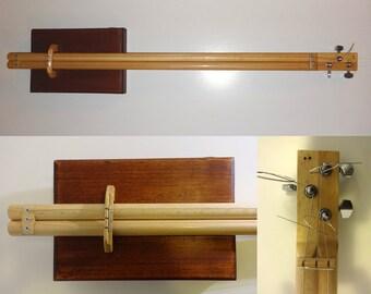 Cigar box guitar - modern design, 3 - string, fretless with pickup