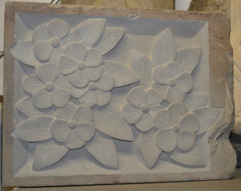 Hand Carved Flowers in Solid Stone Sculpture