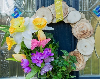 Handmade wooden wreath, beautifully decorated in Spring time flowers and butterflies. Spring time door hanging wreaths.