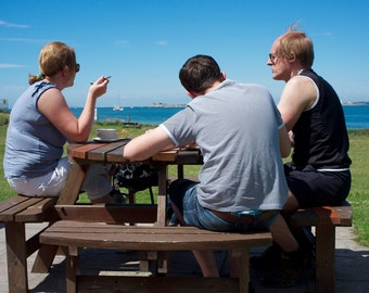 People At A Picnic Bench in England, British Seaside, Fine Art Print, Poster