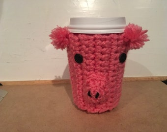 Crotcheted piggy coffee cozie