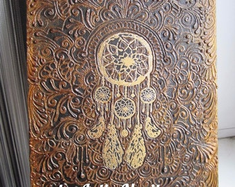 Dreamcatcher, henna painting with the image of the Indian mascot, which protects sleepers from evil spirits