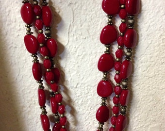 Red 3 strand chunky beaded necklace. Signed SAQ.