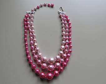 Lovely three strand vintage bead necklace in gorgeous shades of pink.