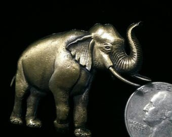 Elephant trunk up brooch