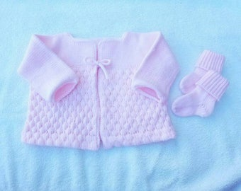 Sweet baby sweater and sock set. Knit with super soft acrylic baby yarn. Wash and dry.