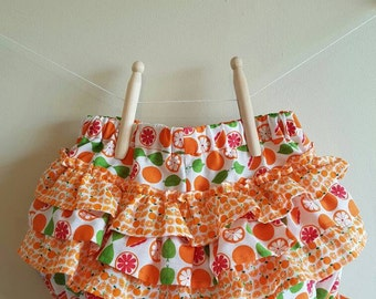 Fancy pants, oranges and ruffles!  Size 12 months (0)