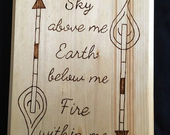 Sky above me, wood burned sign