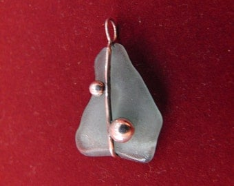 Pendant is glass with adapted miniature sterling silver