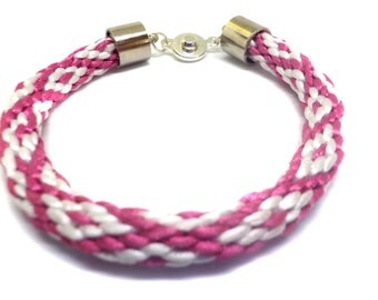 Blue or Pink and white bracelet with diamond shapes that is Kumihimo braided