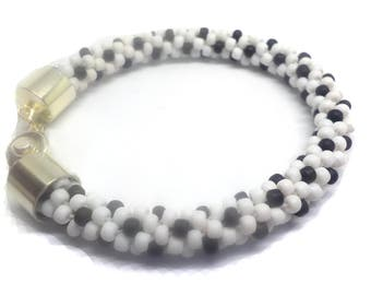 White daisy   bracelet beaded on a Kumihimo braid