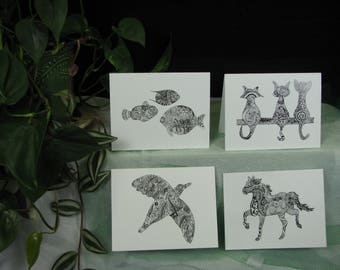 Hand drawn note cards in black and white designs.  Whimsical, finely detailed drawings.