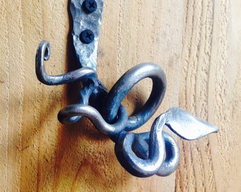 Hand forged Iron coat hook with tendrils and leaf.