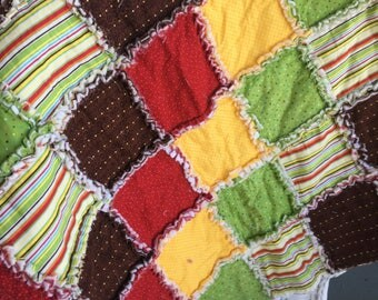 Baby rag quilt in brown yellow red and green
