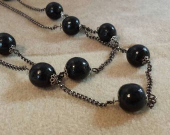 Necklace chain and balls of black wood