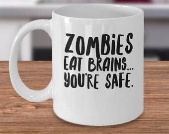 Zombie Coffee Mug - Zombie Gift Idea - Gift For Zombie Fan - Zombies Eat Brains... You're Safe. - Funny Zombie Present