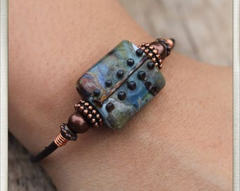 Leather and lampwork bracelet in blues and olive