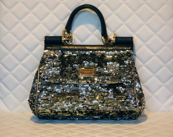 Dolce & Gabbana Authentic evening purse is perfectly small for the night out
