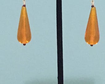 Orange glass tear drop earrings accented with gold plated wire
