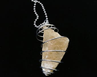 Orange calcite in jewelry cage, Free shipping 27 ball chain