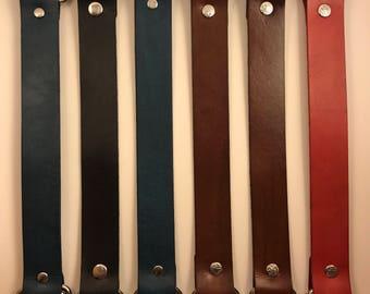 Handcrafted genuine leather furoshiki cloth handles.