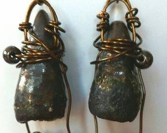 a pair of earrings, earring, ceramic