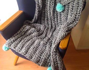 Crochet blanket or throw in grey tones