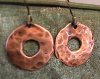 Earring made of hammered copper discs